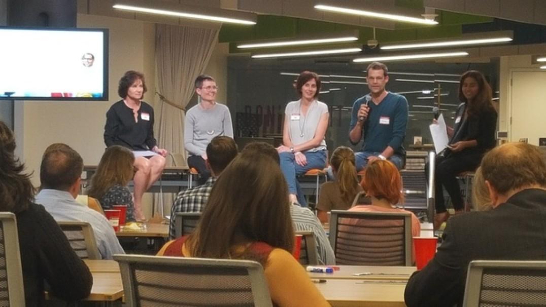 Panelists speak at the Booz Allen Innovation Center