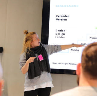 Lotta Salminen presenting the design maturity models. -- Image credit: Tommi Luhtala
