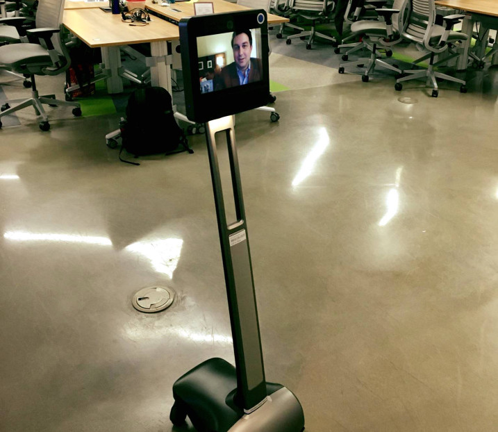 Maga Design's John Gray Parker, who was out of town, still made it to the event by scurrying around on a telepresence robot!